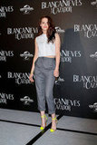 Kristen Stewart paired a short top with gray pants.
