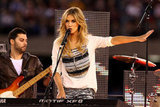 "Delta Goodrem performed her single ""Sitting on Top of the World"" before the State of Origin in Melbourne on May 23."