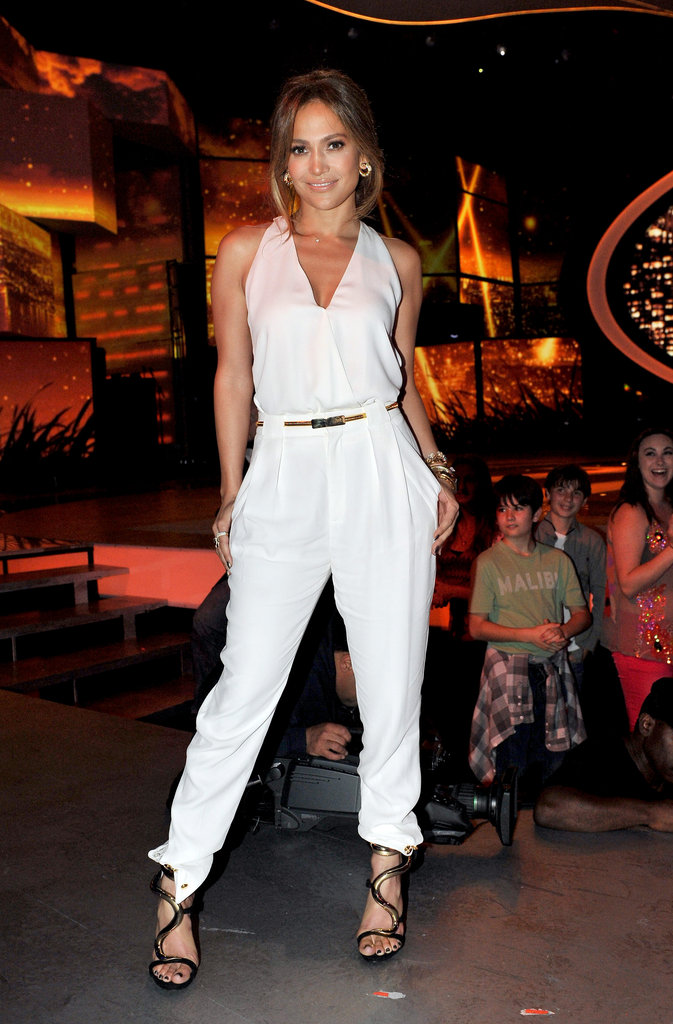 Here Jennifer opted for something more fresh, picking a white halter Gucci top with matching trousers, then finishing her glam look with wavy Giuseppe Zanotti sandals and gold Marina B baubles. We love the illusion that Jennifer is wearing a jumpsuit rather than separates.  6931715