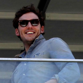 Sam Claflin wore sunglasses.