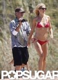 Gwyneth Paltrow flaunted her flawless figure in a tiny red bikini on vacation in Italy with Steven Spielberg in July 2011.