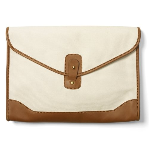 This clutch easily goes from day to night, thanks to a totally transitional canvas material.  Club Monaco Franny Canvas Clutch ($130)