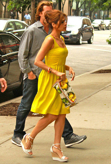 While Eva usually wears printed frocks, on this occasion she sported a solid yellow dress with Chloé wedges and a Stella McCartney clutch.  6935415