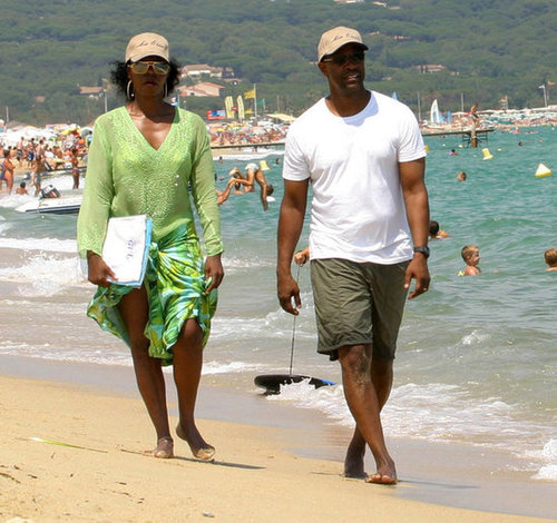 Denzel Washington and his wife, Paulette, dug their toes into the sand for a relaxing stroll in St.-Tropez in July 2005.