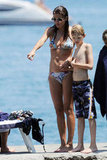 Helena Christensen wore a bikini with son alongside Mingus Reedus while vacationing in Italy in July 2011.