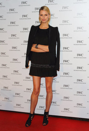 Karolina Kurkova channeled chic party wear with a blazer slung nonchalantly over her LBD.