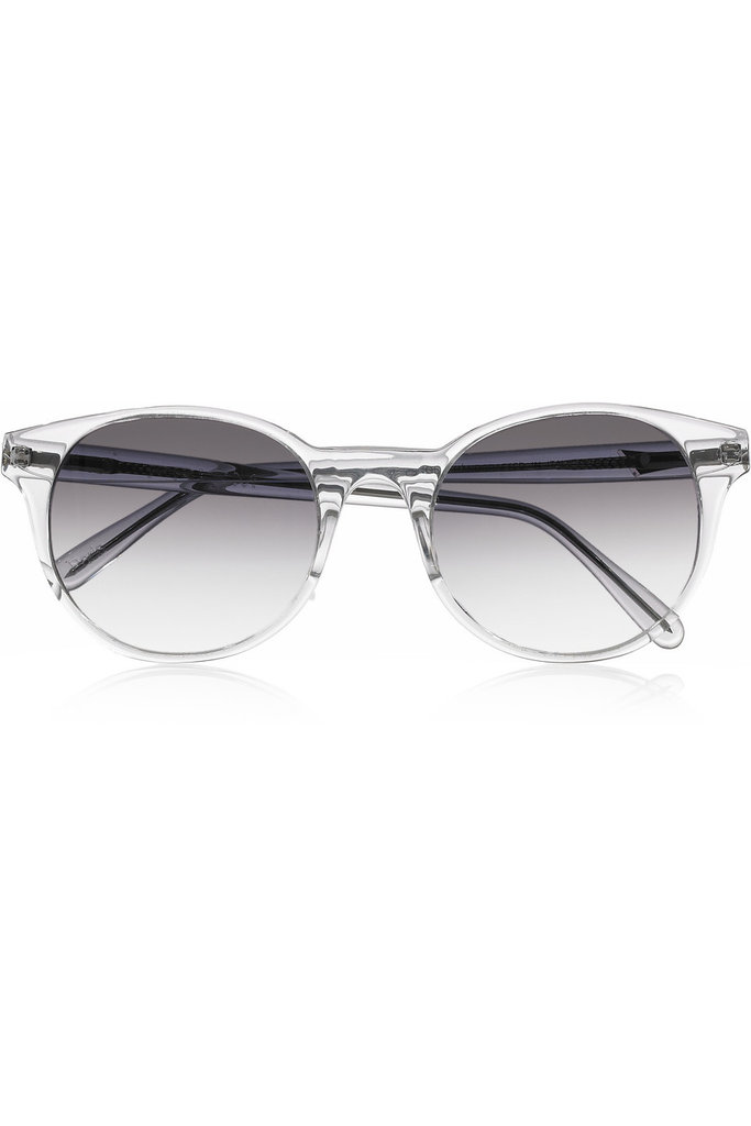 """I treat myself to a new pair of sunglasses every summer. Right now I've got my eye on these. The clear acetate will go with everything."" — Ashley Madekwe Ashley's pick: Prism Paris Round-Frame Acetate Sunglasses ($405)"