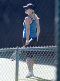 Reese Witherspoon sported a blue tank and black hat on the court.