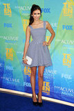 We absolutely love everything about Nina's blue gingham Dolce & Gabbana dress and white clutch at the 2011 Teen Choice Awards — it's the perfect Summer cocktail attire.