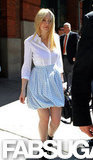 Dakota Fanning tucked a crisp white button-down blouse into her baby-blue polka-dot bubble skirt.