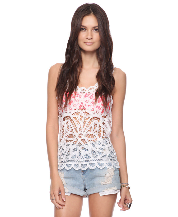 This piece is perfect for throwing on over a bikini top or colored tank. Forever 21 Crochet Boho Top ($20)