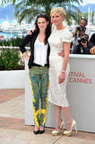 Talk about a fashionable duo — Kristen Stewart and Kirsten Dunst strike a pose at the On the Road photocall. Kristen dressed up her Rebecca Minkoff blazer with a pair of bright printed Balenciaga pants and black pumps. Kirsten wowed in a white laser-cut floral frock by Dolce & Gabbana, and to finish, she wore Charlotte Olympia pumps.
