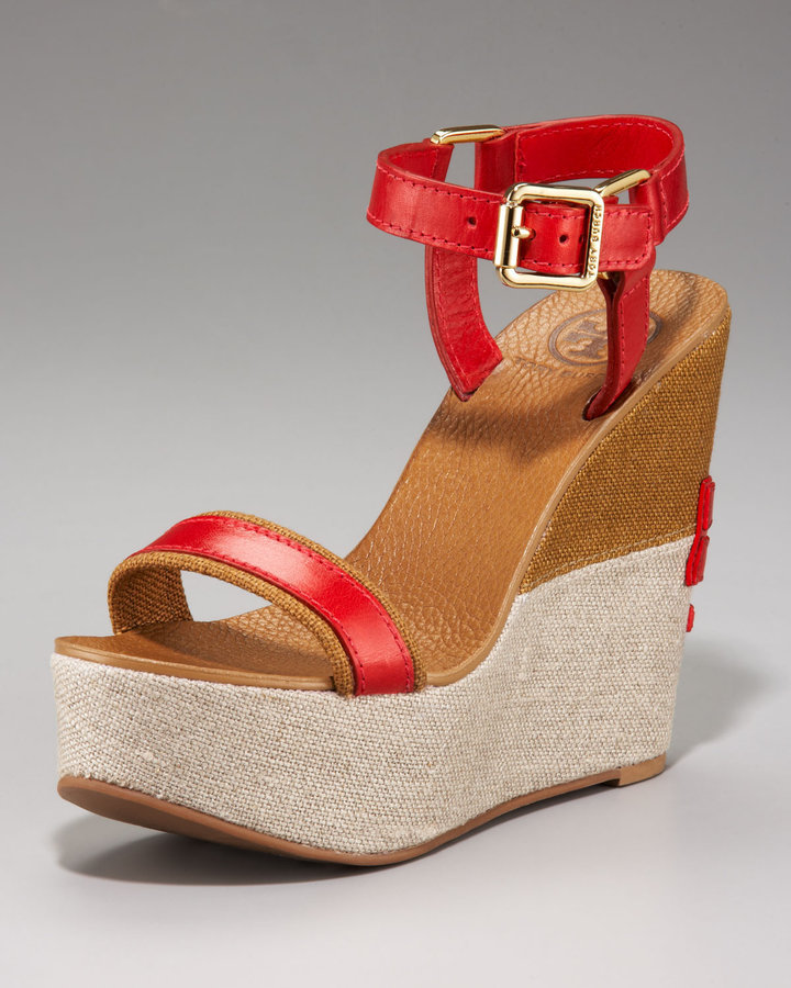 Colorblock wedges are perfect for adding structure to a billowy dress or wide-leg pants.  Tory Burch Carlee Colorblock Wedge Sandal ($325)