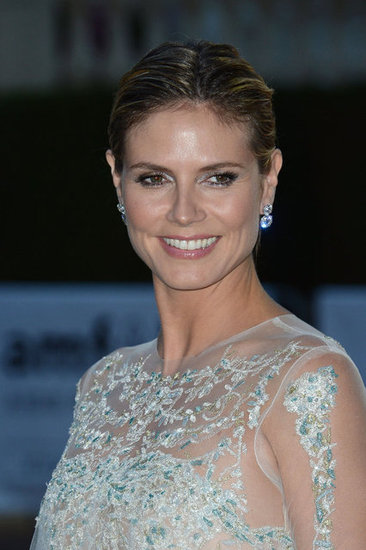 Heidi Klum went for opulent sheer for the evening's festivities.