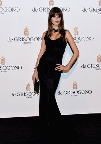 Isabeli Fontana channeled moody glamour in a black, curve-hugging gown and wrap-around choker.