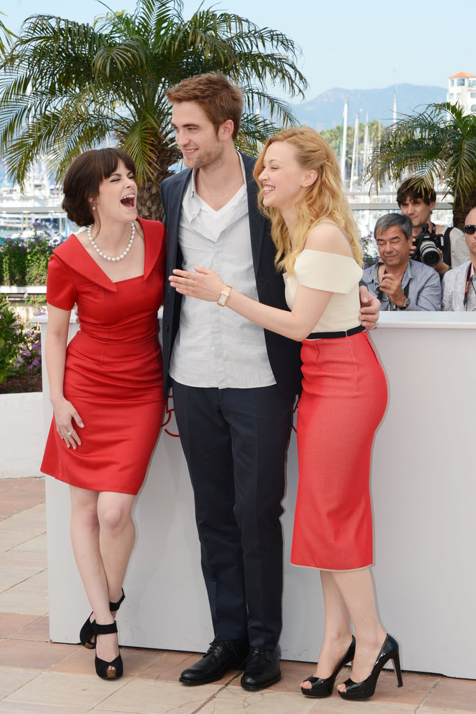 Robert Pattinson laughed with costars Sarah Hadon and Emily Hampshire at the Cosmopolis photocall in Cannes.