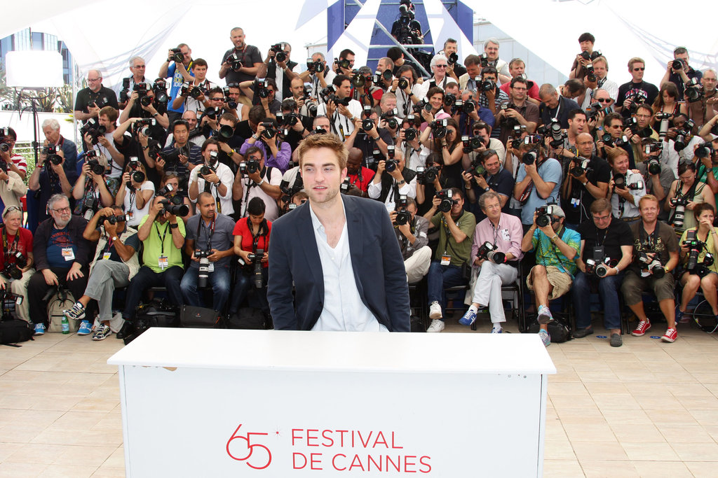 Robert Pattinson posed for photographers at the Cosmopolis photocall in Cannes.
