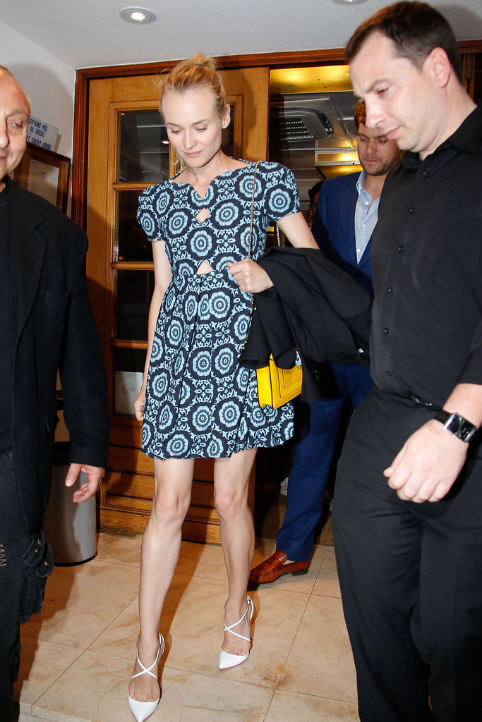 Diane Kruger did lunch in Cannes in a summery Versus sundress and white pumps.