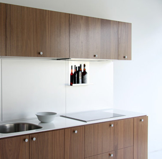 The grain of the wood used for these cabinets brings a great deal of character to the space.  Source: Viola Park