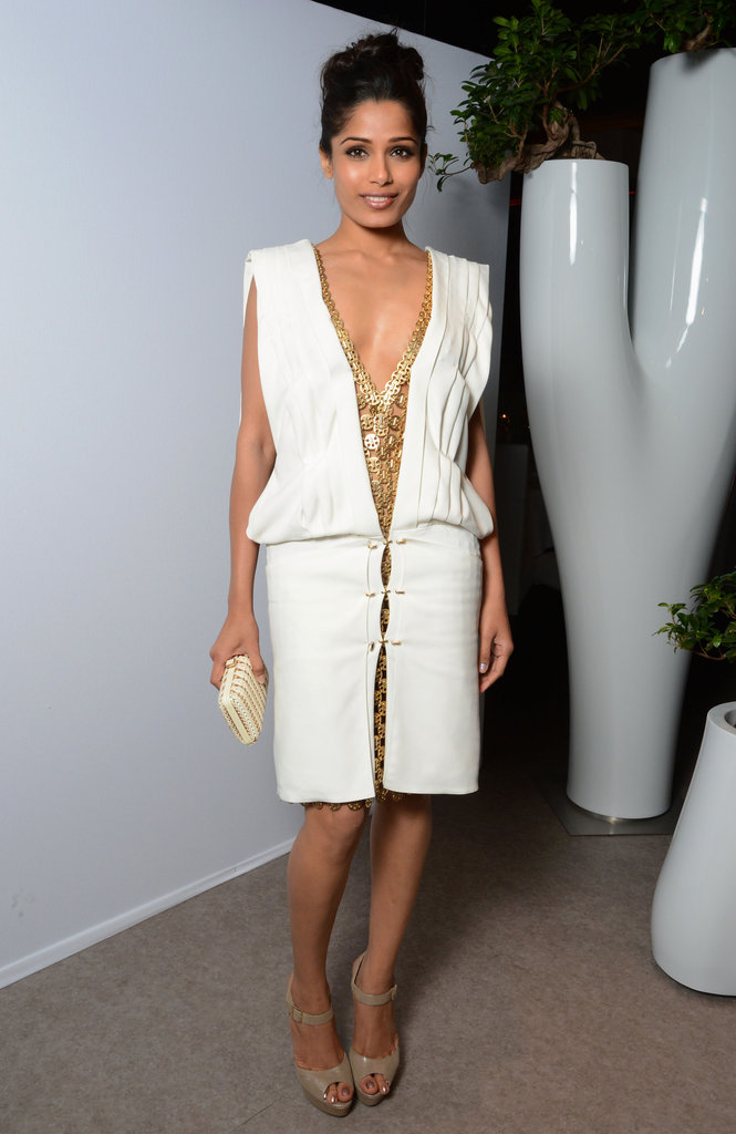 Freida Pinto's white Paco Rabanne dress got a jolt of glam via gilded detailing.