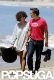 Halle Berry and Olivier Martinez gave each other a glance while walking on the beach.