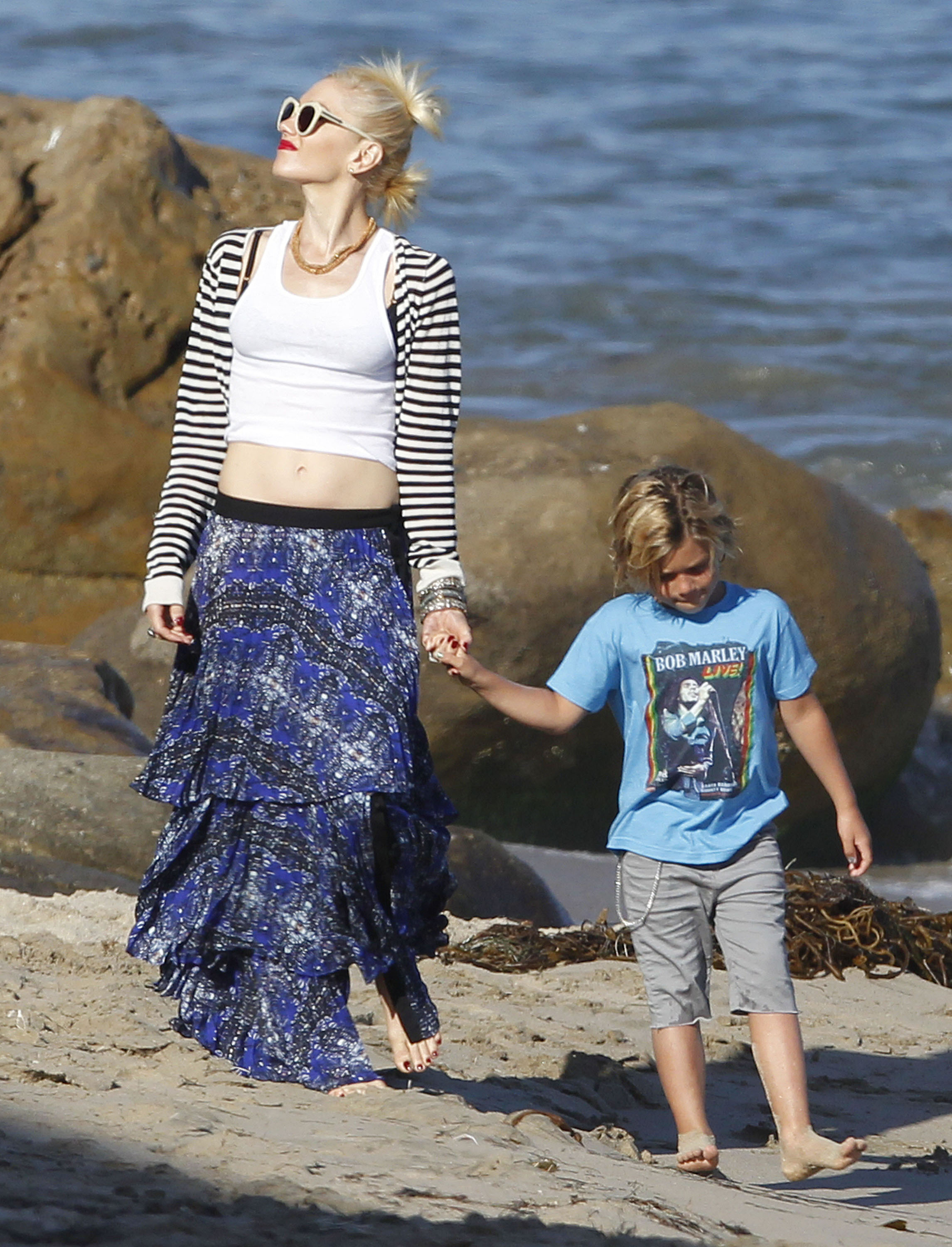 Gwen Stefani held hands with Kingston on the beach in Malibu, CA, in May 2012.