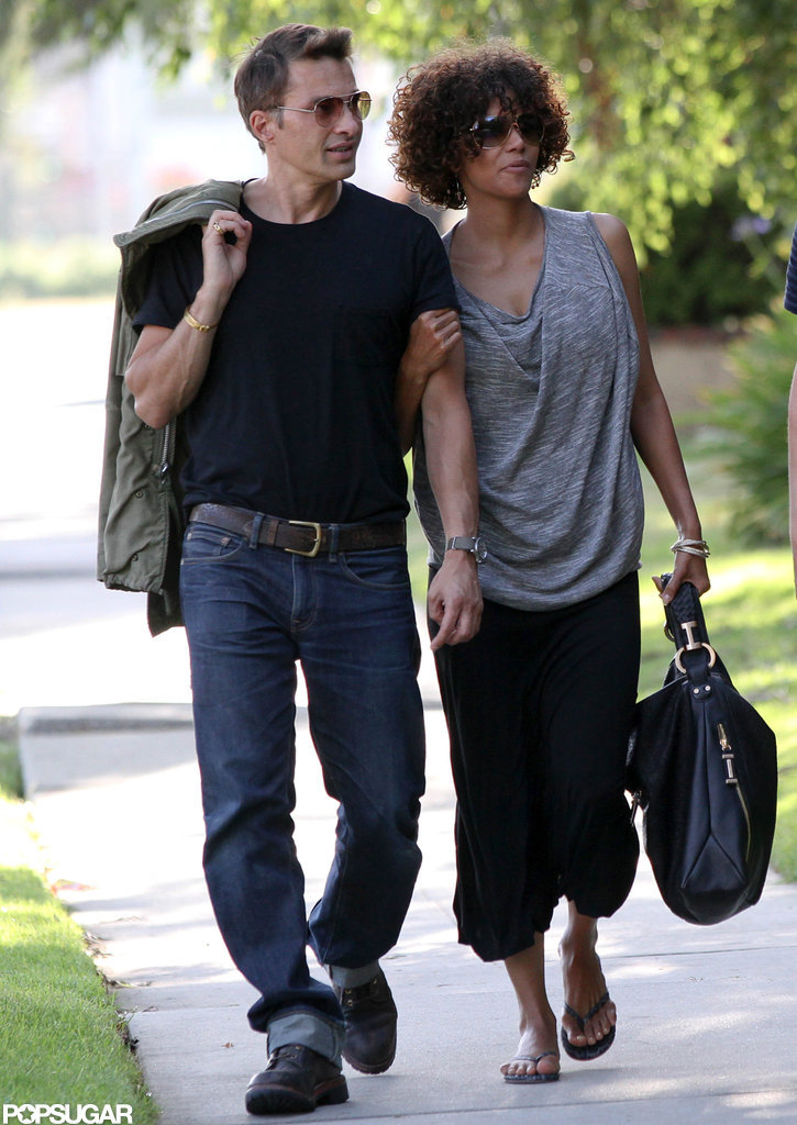Halle Berry held on to Olivier Martinez's arm as he led the way in LA.