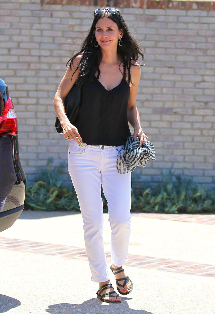 Courteney Cox had fun at Joel Silver's Memorial Day party in LA.