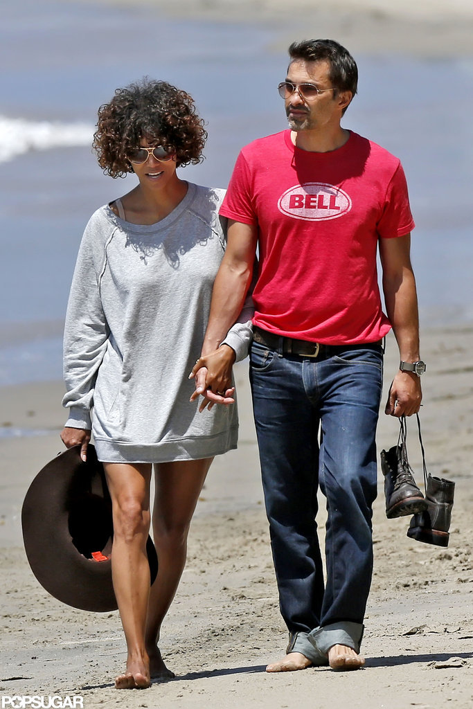 Halle Berry carried her hat while holding hands with Olivier Martinez.