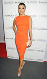 Eva Longoria turned heads in a bright formfitting orange Victoria Beckham sheath and nude Brian Atwood pumps.