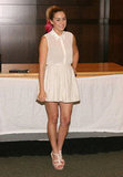Lauren Conrad paired a demure collared blouse with a pleated mini for a charming take on Summer whites.  6999021