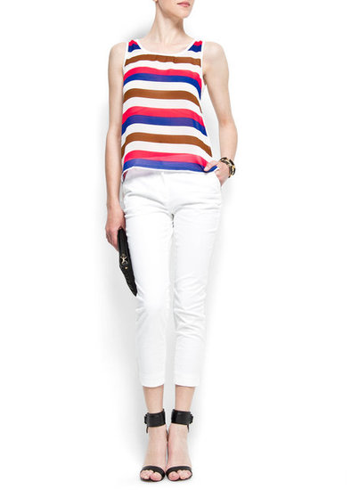 We love the playful colors mixed with a traditional nautical stripe pattern — wear this top with chunky brown sandals and skinny jeans for happy hour. Mango Striped Sheer Top ($30)