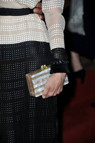 Diane's embellished Edie Parker clutch glammed up her black and white Jenny Packham dress.