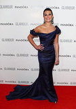 Lea Michele stunned in an ink-blue pre-Fall '12 Zac Posen gown. Since the neckline was an off-the-shoulder drape, she could pair the ensemble with decadent bejeweled drop earrings, too.