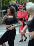 Queen Elizabeth II watched a dance troupe as she visited Chester Zoo as part of her tour of Northwest England on May 17.