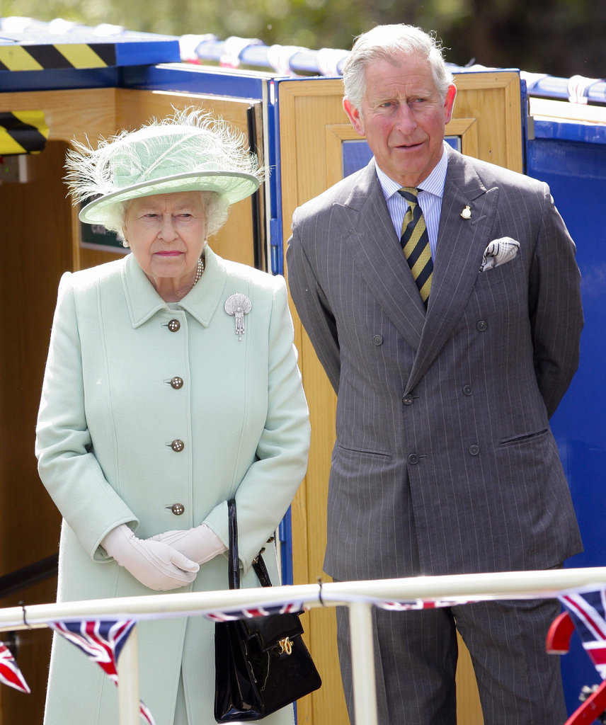 Queen Elizabeth II and Prince Charles, Prince of Wales, traveled down the Leeds and Liverpool Canal on the Pride of Sefton barge on day one of a visit to the Northwest of England on May 16.