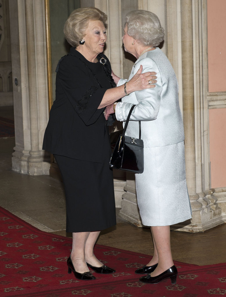 Queen Elizabeth II greeted Queen Beatrix of Holland as she arrived at a lunch at Windsor Castle.
