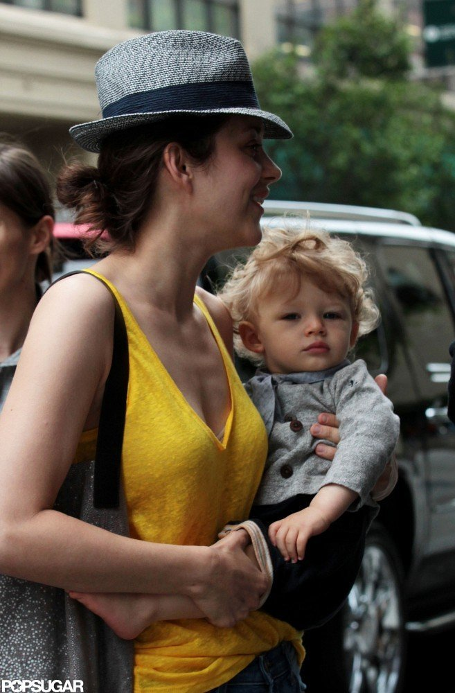 Marion Cotillard carried her adorable baby Marcel to their hotel in SoHo.