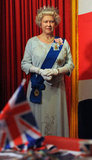A new wax version of Queen Elizabeth II stood tall in her royal garments.