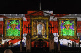 A light show featuring portraits of Queen Elizabeth II created by tiny self-portraits of children was projected onto Buckingham Palace.