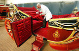 A carriage restorer cleaned the royal carriages ahead of the Queen's Diamond Jubilee celebrations this weekend.
