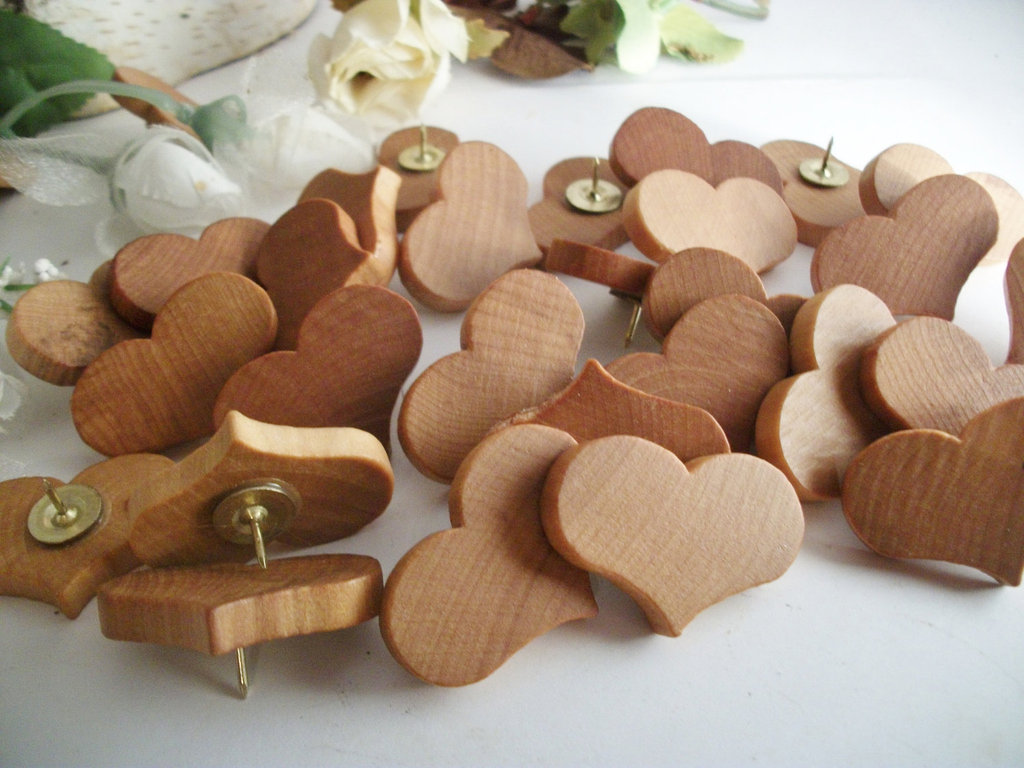 If you're sick of the plain pushpins littering your bulletin board, then buy these charming Wooden Heart Thumbtacks ($13 for 30).