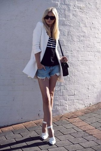 Don't think too hard — this effortless combo relies on a white blazer and basic cutoffs.  Photo courtesy of Tuula