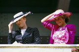 Princess Diana and Sarah Ferguson, Duchess of York, held onto their hats in 1987.