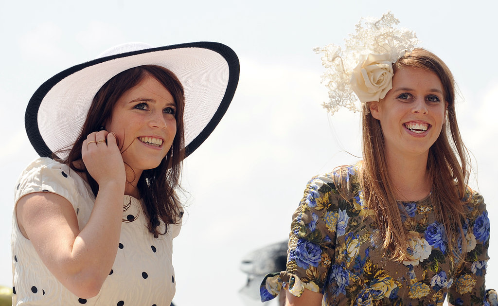 Eugenie and Beatrice, the Princesses of York, laughed together during the 2011 derby.