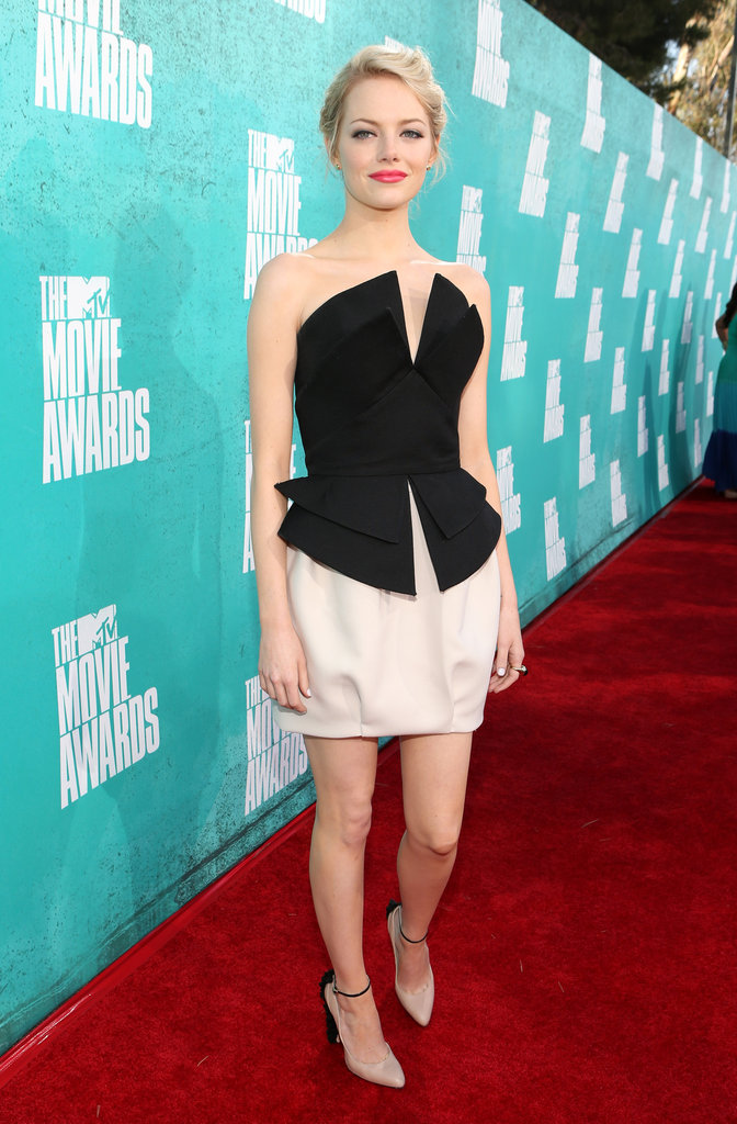 Emma Stone wore a black and white dress for the MTV Movie Awards.