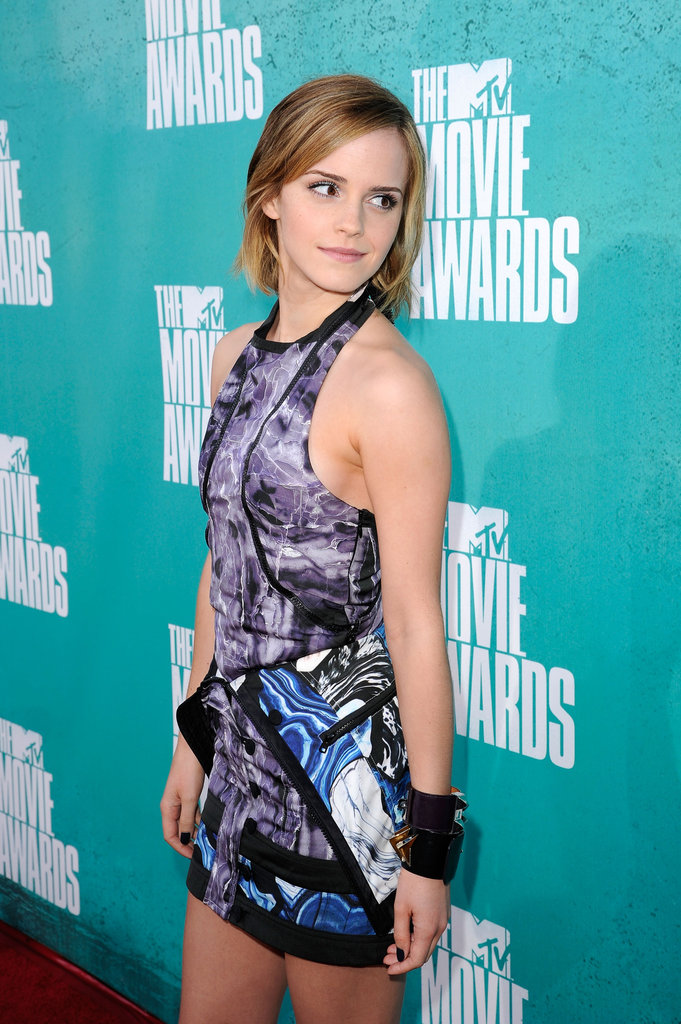 Emma Watson turned heads in a short purple number at the MTV Movie Awards.