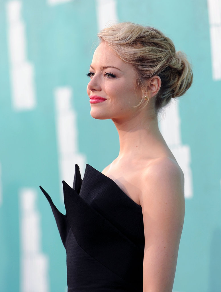 Emma Stone wore her hair back at the MTV Movie Awards.