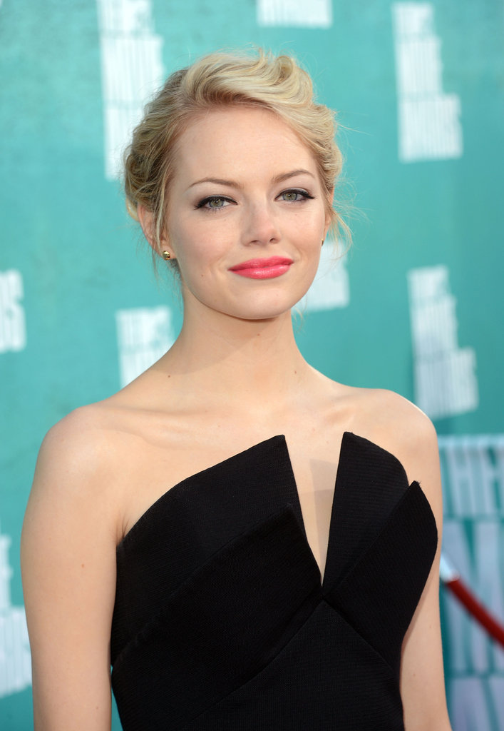 Emma Stone wore a dress with a plunging neckline for the MTV Movie Awards.