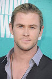 Chris Hemsworth gave a smile on the red carpet at the MTV Movie Awards.